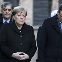 German Chancellor Angela Merkel and Polish Prime Minister Mateusz Morawiecki, from left, visit the former Nazi death camp of Auschwitz-Birkenau in Oswiecim, Poland on December 6, 2019. (Photo/Markus Schreiber via AP)