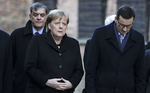 German Chancellor Angela Merkel and Polish Prime Minister Mateusz Morawiecki, from left, visit the former Nazi death camp of Auschwitz-Birkenau in Oswiecim, Poland on Friday, Friday, Dec. 6, 2019. Merkel attend an event in occasion of the 10th anniversary of the founding of the Auschwitz Foundation. (Photo/Markus Schreiber via AP)