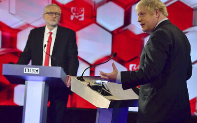Opposition Labour Party leader Jeremy Corbyn, left, and British Prime Minister Boris Johnson, during a head to head live Election Debate at the BBC TV studios in Maidstone, England,  December 6, 2019. ( Jeff Overs/BBC via AP)