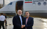 In this photo released on twitter account of Iran's Foreign Minister Mohammad Javad Zarif , Zarif, left, shakes hand with Iranian scientist Massoud Soleimani prior to leaving Zurich, Switzerland for Tehran, Iran, December 7, 2019. (Javad Zarif twitter account via AP)