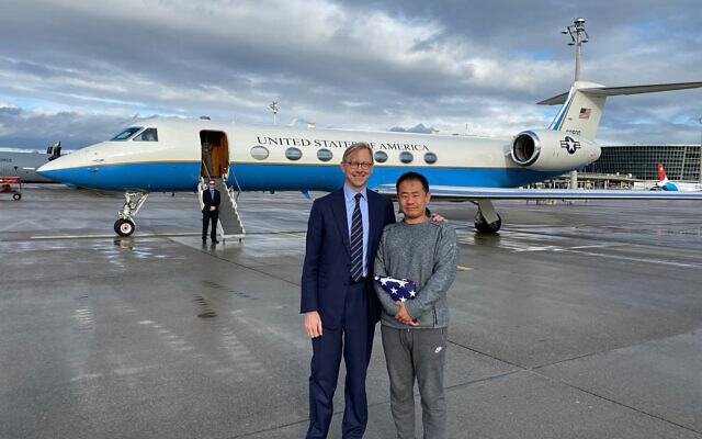 US special representative for Iran Brian Hook stands with Xiyue Wang in Zurich, Switzerland on December 7, 2019.  (US State Department via AP)
