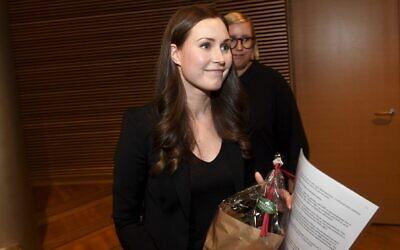 Sanna Marin, after she won the SDP's prime minister candidate vote against Antti Lindtman, in Helsinki, Finland, December 8, 2019. (Vesa Moilanen/Lehtikuva via AP)
