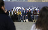 Young activists from the 'Fridays For Future' climate protest Movement form a human chain at the COP25 Climate summit in Madrid, Spain, December 9, 2019. (Andrea Comas/AP)
