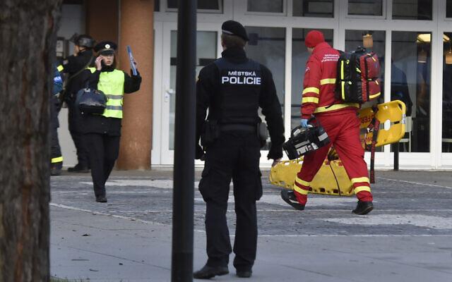 Police personnel and paramedics outside the Ostrava Teaching Hospital after a shooting incident in Ostava, Czech Republic,  Dec. 10, 2019 (Jaroslav Ozana/CTK via AP)