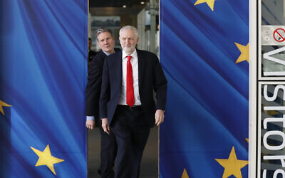 In this March 21, 2019 file photo, British Labour Party leader Jeremy Corbyn, right, and Keir Starmer, Labour Shadow Brexit secretary, leave EU headquarters prior to an EU summit in Brussels. (AP Photo/Frank Augstein, File)