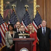 From left, House Speaker Nancy Pelosi, House Financial Services Committee Chair Maxine Waters (California Democrat), House Foreign Affairs Committee Chair Eliot Engel (New York Democrat), House Judiciary Committee Chair Jerrold Nadler (New York Democrat), House Committee on Oversight and Reform Chair Carolyn Maloney (New York Democrat), House Ways and Means Committee Chair Richard Neal (Massachusetts Democrat) and House Permanent Select Committee on Intelligence Chair Adam Schiff (California Democrat) unveil articles of impeachment against US President Donald Trump at a news conference on Capitol Hill in Washington, December 10, 2019. (AP Photo/Susan Walsh)