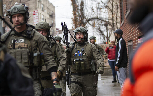 Police officers arrive at the scene following reports of gunfire, December 10, 2019, in Jersey City, New Jersey. (AP Photo/Eduardo Munoz Alvarez)