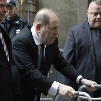 Harvey Weinstein, center, arrives for a court hearing, December 11, 2019, in New York. (AP Photo/Mark Lennihan)