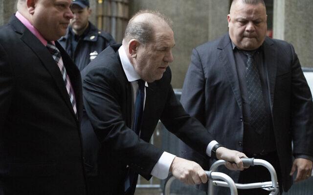 Harvey Weinstein, center, arrives for a court hearing, Wednesday, Dec. 11, 2019 in New York. (AP Photo/Mark Lennihan)