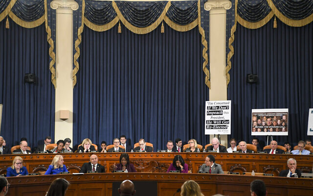 The US House Judiciary Committee at work late into the evening at a markup of the articles of impeachment against US President Donald Trump, on Capitol Hill in Washington, December 12, 2019. (Jonathan Newton/The Washington Post via AP, Pool)