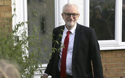 Labour Party leader Jeremy Corbyn leaves his home in Islington, north London, December 13, 2019, after defeat by Prime Minister Boris Johnson in Britain's election. (Isabel Infantes/PA via AP)