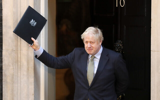 Britain's Prime Minister Boris Johnson waves after addressing the media outside 10 Downing Street in London, Friday, Dec. 13, 2019. Johnson's Conservative Party won a thumping majority of seats in Britain's Parliament.(AP Photo/Frank Augstein)