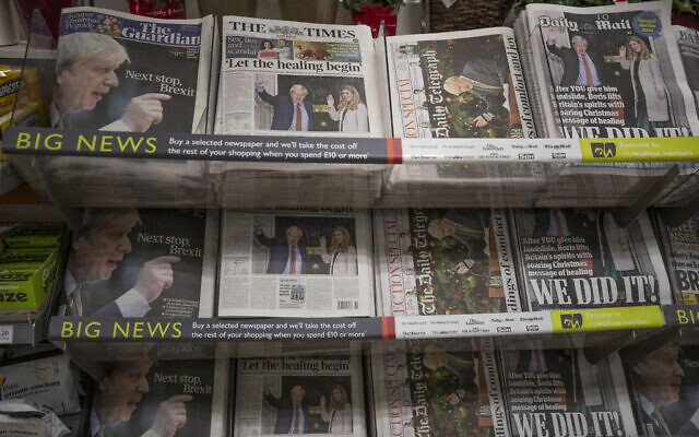 Newspapers sit on display for sale with their front pages reporting on the general election in a supermarket in south west London, December 14, 2019. (AP Photo/Matt Dunham)