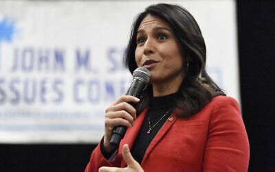 Democratic presidential candidate US Rep. Tulsi Gabbard, D-Hawaii speaks to Democrats gathered at the Spratt Issues Conference in Greenville, S.C., Saturday, Dec. 14, 2019.  (AP Photo/Meg Kinnard)