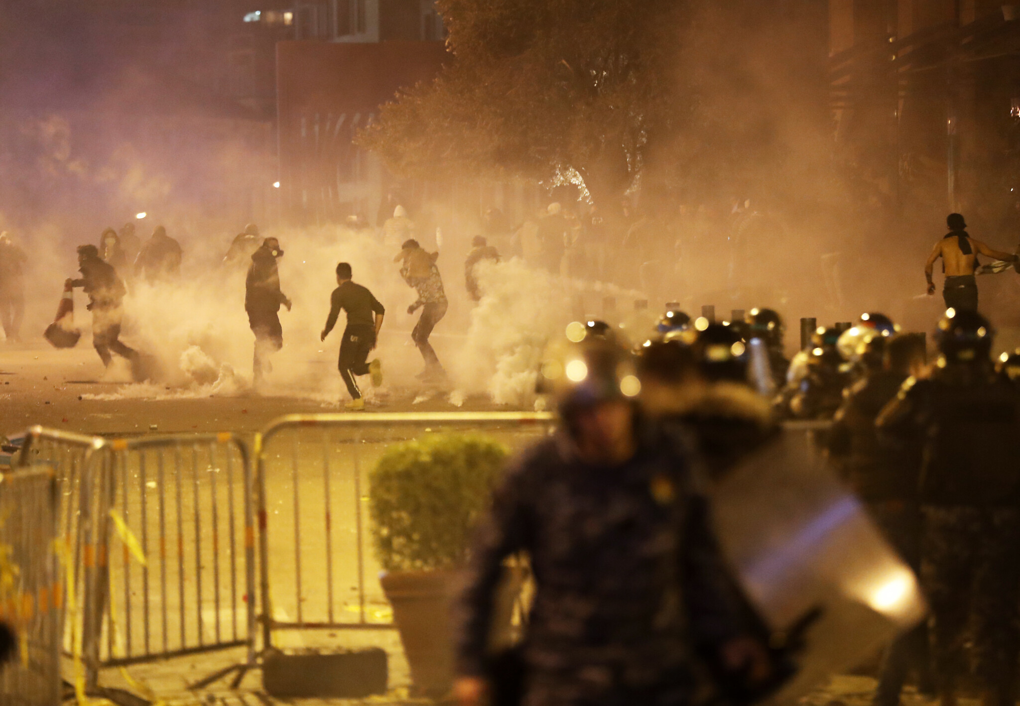 Dozens hurt as violent clashes between police, protesters engulf ...