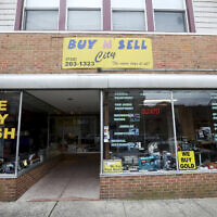 The family-owned Buy n Sell pawnshop searched by the FBI over the weekend is seen in Keyport, New Jersey, December 15, 2019. (Ed Murray/NJ Advance Media via AP)