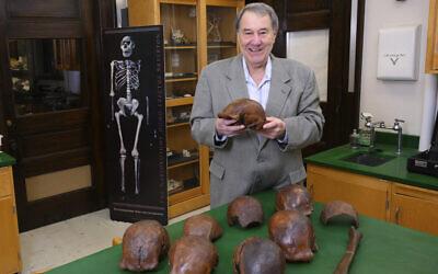 Professor Russell Ciochon holds a cast of a Homo erectus skull at his lab in Iowa City, 2019. (Tim Schoon/University of Iowa via AP)