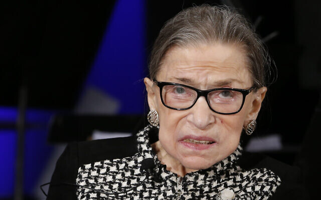 Supreme Court Justice Ruth Bader Ginsburg looks up as she speaks about the antics of her son as she speaks with author Jeffrey Rosen at the National Constitution Center Americas Town Hall at the National Museum of Women in the Arts, Tuesday, Dec. 17, 2019 in Washington. (AP Photo/Steve Helber)