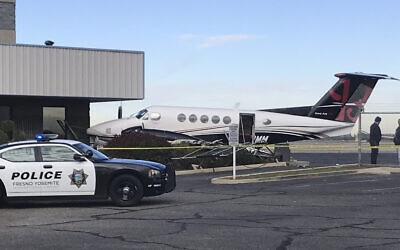A small plane sits parked after it was crashed into a fence by a 17-year-old girl, December 18, 2019, at the Fresno Yosemite International Airport in Fresno, California (Jim Guy/The Fresno Bee via AP)