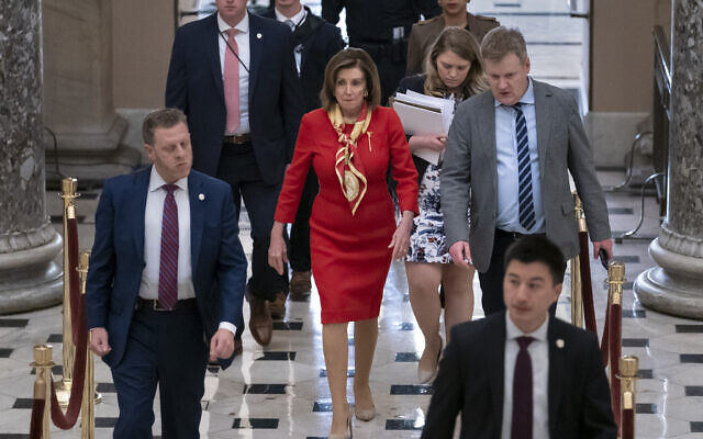 House Speaker Nancy Pelosi (C) at the Capitol in Washington, December 18, 2019. (AP Photo/J. Scott Applewhite)
