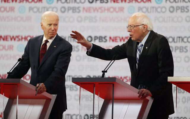 Democratic presidential candidate Sen. Bernie Sanders, I-Vt., speaks as former Vice President Joe Biden listens during a Democratic presidential primary debate Thursday, Dec. 19, 2019, in Los Angeles. (AP/Chris Carlson)