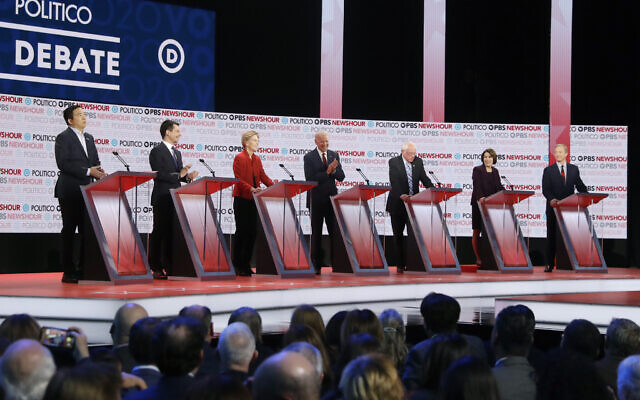 Democratic US presidential candidates from left, entrepreneur Andrew Yang, South Bend Mayor Pete Buttigieg, Sen. Elizabeth Warren, D-Mass., former Vice President Joe Biden, Sen. Bernie Sanders, I-Vt., Sen. Amy Klobuchar, D-Minn., and businessman Tom Steyer participate in a Democratic presidential primary debate December 19, 2019, in Los Angeles. (AP/Chris Carlson)