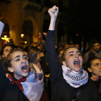 Protesters chant slogans during ongoing protests against the Lebanese political class, in downtown Beirut, Lebanon, December 22, 2019. (AP Photo/Bilal Hussein)