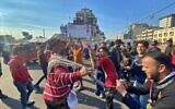 Anti-government protesters dance in Tahrir Square in Baghdad, Iraq, December 22, 2019. (AP Photo/Khalid Mohammed)