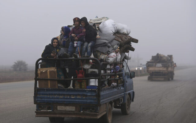 Civilians ride in a truck as they flee Maaret al-Numan, Syria, ahead of a government offensive, December 23, 2019. (Ghaith al-Sayed/AP)