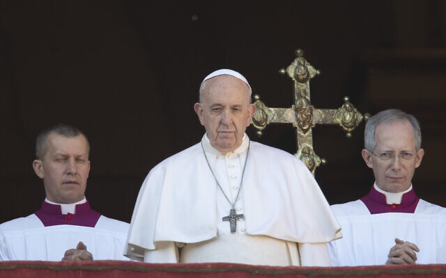 Pope Francis looks at the crowd after he delivered the Urbi et Orbi (Latin for 'to the city and to the world' ) Christmas' day blessing from the main balcony of St. Peter's Basilica at the Vatican, December 25, 2019. (Alessandra Tarantino/AP)