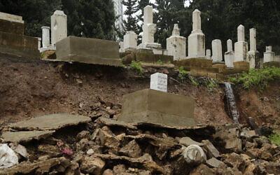 Graves from a Jewish cemetery lie on a sidewalk after it collapsed following heavy rains in the Sodeco area of Beirut, Lebanon, December 26, 2019. (AP Photo/Hassan Ammar)
