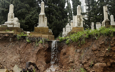 Graves in a Jewish cemetery sit damaged from heavy rains in the Sodeco area of Beirut, Lebanon, December 26, 2019/ (AP Photo/Hassan Ammar)