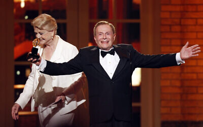 In this June 7, 2009, file photo, Jerry Herman accepts his Special Tony Award for Lifetime Achievement in the Theater from Angela Lansbury at the 63rd Annual Tony Awards in New York. (AP Photo/Seth Wenig, FILE)