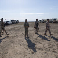 Army commanders tour the operations sectors of the Iraqi army Seventh Brigade, at the start of the eighth phase of the operation, in Anbar, Iraq, Sunday, Dec. 29, 2019. (AP Photo/Nasser Nasser)