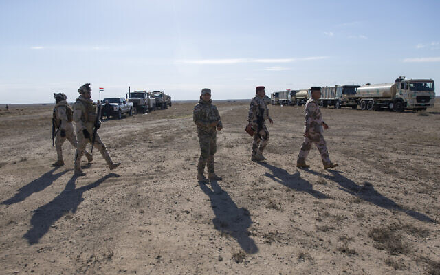 Army commanders tour the operations sectors of the Iraqi army Seventh Brigade, at the start of the eighth phase of the operation, in Anbar, Iraq, Sunday, Dec. 29, 2019. An Iraqi general said Sunday that security has been beefed up around the Ain al-Asad air base, a sprawling complex in the western Anbar desert that hosts US forces, following a series of attacks. (AP Photo/Nasser Nasser)