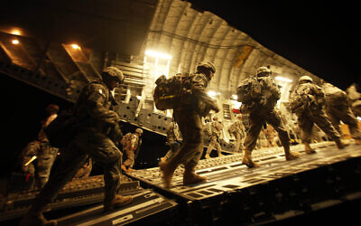 Illustrative: US Army soldiers from 2nd Brigade, 10th Mountain Division board a C-17 aircraft at Baghdad International Airport as they begin their journey to the United States, July 13, 2010. (Maya Alleruzzo/ AP/ File)