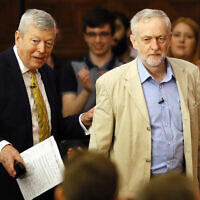 Jeremy Corbyn, leader of Britain's Labour Party, right, with former Labour MP Alan Johnson, at an event in London on April 14, 2016. (AP Photo/Kirsty Wigglesworth)