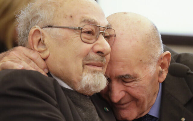Holocaust survivors Sami Modiano, right and Piero Terracina hug each other during an event to commemorate the International Holocaust Remembrance Day, in the Rome's Capitol Hill, Friday, Jan. 27, 2017. (AP Photo/Alessandra Tarantino)