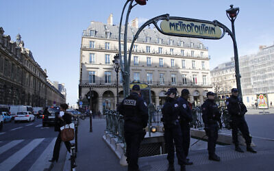 Illustrative: Police officers stand on patrol at a Metro station outside the Louvre museum in Paris, February 3, 2017. (AP Photo/Christophe Ena)