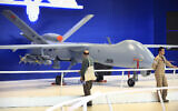 Illustrative -- Visitors at the International Defence Industry Fair, IDEF'17, in Istanbul, walk past a Turkish made drone aircraft at a booth, Wednesday, May 10, 2017 (AP Photo/Lefteris Pitarakis)