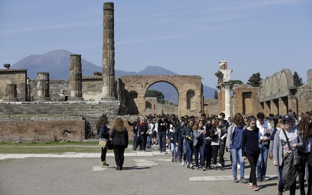 Illustrative: Tourists gather at the Pompeii ancient site near the Villa of Mysteries on the occasion of its presentation to journalists in Pompeii, Italy, Friday, March 20, 2015. (AP Photo/Gregorio Borgia)