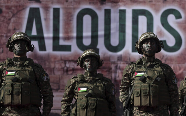 Palestinian fighters from Izz ad-Din al-Qassam Brigades, the military wing of Hamas, attend a rally marking the 30th anniversary of the terror group, in Gaza City, December 14, 2017. (AP Photo/ Khalil Hamra)