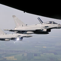 Illustrative: Royal Air Force Eurofighter Typhoon fighter jets escort a transport plane, above eastern Romania, Friday, April 27, 2018. (AP Photo/Vadim Ghirda)