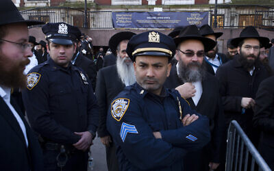 Illustrative: New York City police officers watch as rabbis gather for a group photo at the Chabad-Lubavitch World Headquarters,Sunday, Nov. 4, 2018, in New York. More than 5,000 of the orthodox Jewish leaders from around the world are taking part in the annual meeting.  (AP Photo/Mark Lennihan)