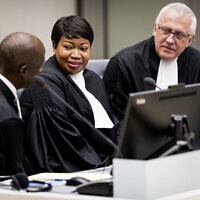 Prosecutor Fatou Bensouda, center, and Deputy Prosecutor James Stewart, right, attend the first audience with the chief of Central African Republic's soccer federation Patrice-Edouard Ngaissona at the International Criminal Court (ICC) in The Hague, the Netherlands on January 25, 2019. (Koen Van Well/Pool photo via AP)