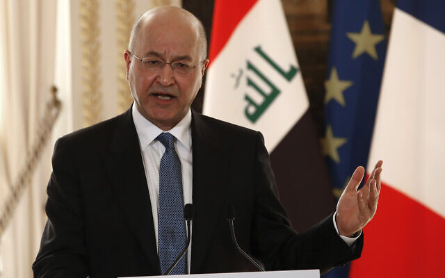 Iraqi President Barham Saleh speaks during a press conference with French President Emmanuel Macron at the Elysee Palace in Paris, February 25, 2019. (AP Photo/Christophe Ena, Pool)