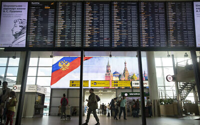 Illustrative: Passengers walk past a departure board at Sheremetyevo international airport in Moscow, Russia, July 8, 2019. (AP Photo/Pavel Golovkin)