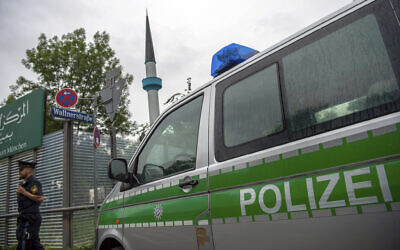 Illustrative: A police van in Munich, Germany on July 11, 2019. (Lino Mirgeler/dpa via AP)