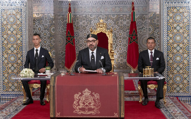 In this photo provided by the Moroccan News Agency (MAP), Morocco's King Mohammed VI, center, accompanied by his son Crown Prince Moulay Hassan, left, and brother Prince Moulay Rashid addresses the Nation in a speech aired on TV, at the Royal Palace in Tetouan, Morocco, on Monday July 29, 2019. (Moroccan Royal Palace via AP)