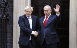 British Prime Minister Boris Johnson, left, welcomes Israel's Prime Minister Benjamin Netanyahu outside Downing Street in London, September 5, 2019. (AP Photo/Alastair Grant)